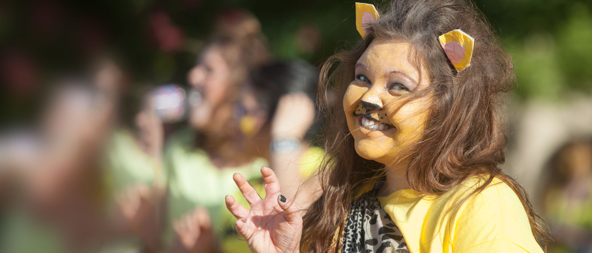 Girl's face painted as Lion mascot
